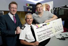 GMPs  Chief Constable, Sir Peter Fahy, presents a cheque for £22,484.55 to two local charities. The funds will divided be equally between Key 103s Cash for Kids appeal and Retrak.The money was raised at a charity dinner hosted by Sir Peter in April at Manchester's Midland Hotel. Various local organisations and individuals donated unique items for the raffle and auction and over 220 people attended the event.