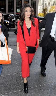 Hitting the promo trail: Sandra Bullock was chic and businesslike in a stylish red pantsui...