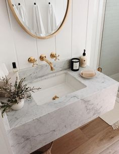 It looks like we will be replacing all of the hardwood floors throughout our entire home in a couple weeks since weve. White Marble Bathrooms, Small Bathroom, Bad Inspiration, Bathroom Inspiration, Floating Sink, Gold Faucet, Modern Farmhouse Bathroom, Bathroom Design Luxury, Home And Deco