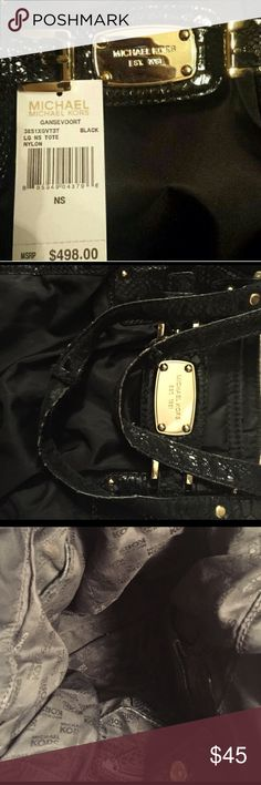 Michael Kors black medium gavensoort handbag Authentic, nylon medium black python print medium size handbag. Impeccable condition. Wear and tear on shoulder straps, repairable. The place where the shoulder straps go into the main bag has been wonderfully repaired by a professional. Took extensive photos (including photo of inside). Michael Kors Bags Shoulder Bags