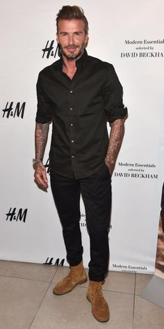 David Beckham wearing Saint Laurent Cigar Brushed-Suede Boots, H&M Cotton Shirt Regular Fit in Black and H&M Suit Joggers in Black