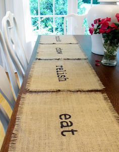 Burlap placemats. SO easy! Cut to fit, fringe the sides by pulling some of the strings and personalize with rubber stamps or free hand if you're brave.