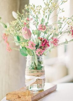 Spring is here! A rustic & relaxed wedding centerpiece. Gorgeous flowers! {Amy Arrington Photography}