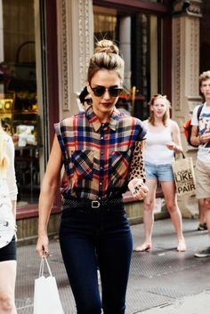 Love the cut on this buttoned up plaid blouse, paired w skinny jeans, polka dot belt & leopard clutch