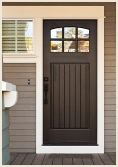 front door color with gray siding | black doors give even the most humble…