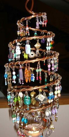 Fantastic earring storage/display - copper tubing wrapped with chain to hook earrings onto.