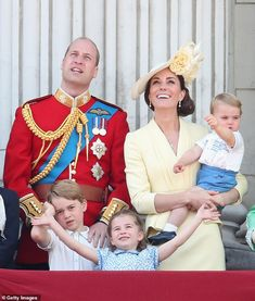 Prince George (bottom left), Princess Charlotte (bottom middle) and Prince Louis of Cambri...