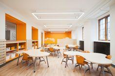 Concevoir l'école primaire de l'avenir dans un édifice patrimonial de plus de 11 000m2 construit en 1896, voilà le défi relevé par Taktik Design pour l'Aca