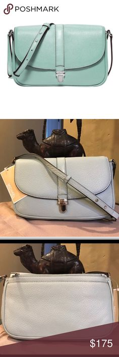 """• Michael Kors Celadon Charlton Crossbody purse • Beautiful NWT Michael Kors Charlton Celadon blue Crossbody purse. 100% authentic, comes with care card and tags still attached. No flaws! Retails for $198. Dimensions: 9"""" L x 6"""" H x 2"""" W Michael Kors Bags Crossbody Bags"""