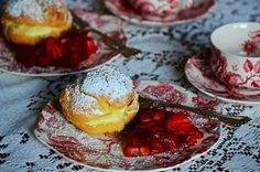 Cream puffs with strawberries.