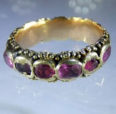 17th century gold and rubies eternity ring. Late seventeenth century gold and rubies ring. The rubies are backed and foiled. Some of the rubies are in chipped condition but not more than expected from a ring of this age. Probably Italian ca 1680 .