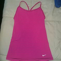 Nike Tanktop Pink and burgundy-like stripes with racer back spaghetti  straps, in great condition with built in bra. Slightly padded, full coverage.  Dry-fit, slim fit. Nike Tops Tank Tops