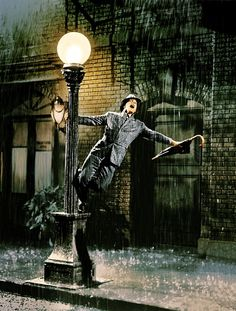 singing in the rain. All time favorite musical from the 1950s.  Gene Kelly!