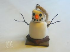 S'more snowman ornament made out of clay.  There is a tutorial on the post.  Would be cute as a gift with the makings of s'mores to go with it!
