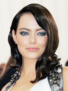 Pale-skinned girls can go a few shades darker than brunette. Emma Stone's almost-black hair colour looks chic and sophisticated.