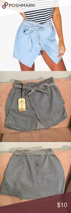 """Super Cute Denim Skirt/Skort US size 6, UK size 10. They run on the smaller side. Brand new, unworn, w/ tags. These denim shorts are """"handcrafted with love"""" and can easily be dressed down for the daytime or styled up for a night out. You'll have everyone fooled thinking you're wearing the cutest denim skirt ever because of the way they rest on the body. I bought these with my fingers crossed that they'd fit, but they don't :( so I'm hoping to find them a good home! Shorts Skorts"""