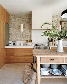 Gorgeous rock walls and wood kitchen.