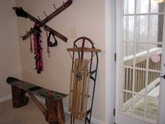 repurpose an old pair of skis for a coat rack. The two skis were drilled and screwed together in the center and then he mounted hooks for hanging jackets, etc.