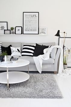Black  white, wise words on the wall, green plants to soften it all up, and a cozy couch with lots of pilows.