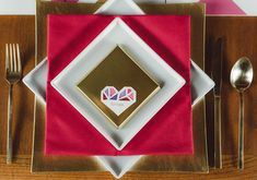 square white plates, pink napkins and geometric heart place cards