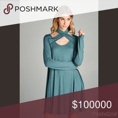 Mock wrap jersey knit dress with side pockets Solid rayon jersey knit flared dress with long sleeves, side pockets, and mock wrap halter neck collar. Dresses