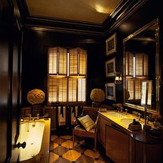 Bathroom-Blakes Hotel London A chair, dark and romantic mood ,generous bath surround, double sinks, art and artifacts, wooden blind shutters, checkerboard floor