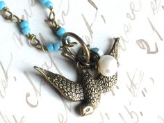 Antique Brass Sparrow Bird Necklace on Turquoise by InGodsHands
