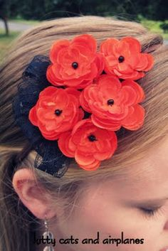 poppy headband - uses those fake flowers you buy at the craft store, but could easy make your own too.