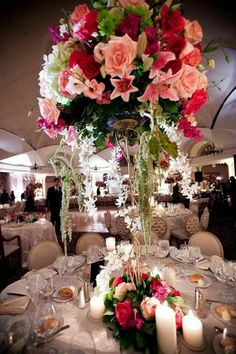 15ft Gold Stands holding overflowing florals...beautiful!!