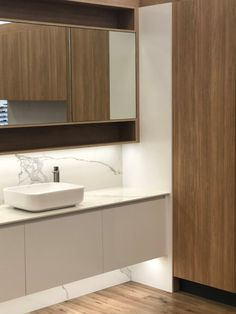 We love the mix of wood and marble tones in this new bathroom display. On Show at Joyce Kitchens Osborne Park. Custom Cabinets, Washing Clothes, Perth, Creative Design, Laundry Room, Bathroom Ideas, Kitchens, Marble, Kitchen Cabinets