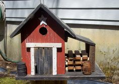 Primitive  Birdhouse Rustic Country Wood Pile Barn Red Yard Outdoors. $35.99, via Etsy.