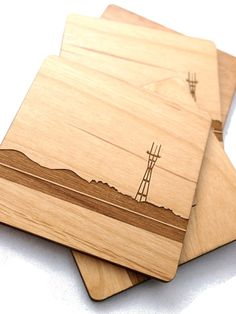 "Posavasos_ San Francisco skyline wooden coasters. $30 for a set of 6. also available for Chicago skyline and customizable with ""your name"""