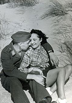 Luftwaffe soldier and young lady in the dunes.