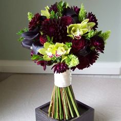 bridal bouquet with Hot Chocolate mini callas, burgundy dahlias, Black Bacarra roses, Mariska spray roses, green cymbidium orchids, bells of Ireland, and myrtle Photo By: Floral Verde LLCvendors: Floral Verde LLC