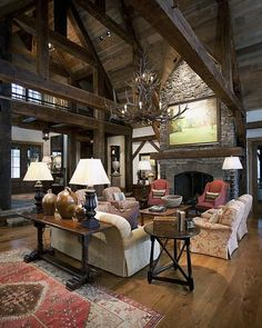Rustic elements with traditional charm, cozy.  I would add another rug.