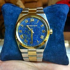 Michael kors big gave watch Authentic used 5 times Michael kors two toned watch with big blue face. Rare and beautiful piece. It fits small wrist like 6.5 inches  wrist. Maybe michael kors can provide extra links.Need new battery. I don't have the original box but will come with my other Michael kors box and pillow. Very beautiful and eye catching piece. What you see is what you get. :) Michael Kors Accessories Watches