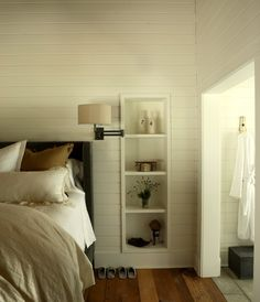 Built-in shelves in modern country bedroom by The Iron Gate