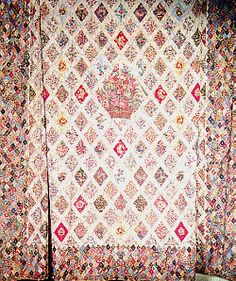 The quilt Jane Austen and her family made, hanging in her house in Chawton.