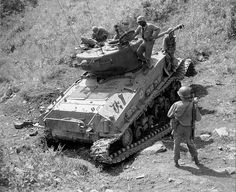 Korean War - 113-16-1 by Morning Calm News, via Flickr ES113-16-1 (SC381830) Men of the 2nd Platoon, B Co 10th Engineer Battalion check a tank for booby-traps and the area for mines. 8 Oct 1951.