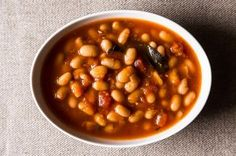 White Bean Soup - This is a simple, tomatoey bean soup that will serve you well all week long! Directions Put the beans in a large pot and add enough water to cover them by at least 2 inches. Add a large pinch of . Ham And Bean Soup, White Bean Soup, White Beans, Bean Stew, White Bean Recipes, Bean Soup Recipes, Meatless Recipes, Quick Recipes, Free Recipes