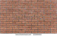 Red brick wall. Red brick walls. Uniform brickwork