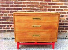 mid-century dresser with red legs