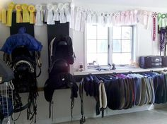 Saddle pads to the right, saddles up the middle, cubbies on the left?