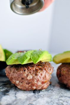 Garlic Bacon Avocado Burger recipe! Its so dreamy and gorgeous paired with a quick veggie side. We love this whole30 approved recipe for a quick & easy emergency meal! | thepikeplacekitchen.com