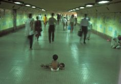 Homeless brothers go ignored in Bombay Central Station, Mumbai, 1995 -- by Raghu Rai