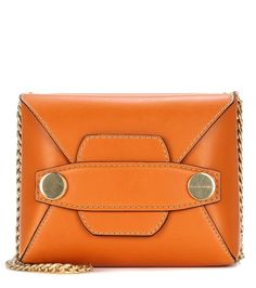 Stella McCartney - Stella Popper Small faux-leather shoulder bag - We love the retro feel of Stella McCartney's vegan-friendly Stella Popper Small shoulder bag. Crafted from honey-hued faux leather, this style features an envelope-inspired flap silhouette with dual internal compartments. Glossy golden hardware and black trim lends this piece standout appeal. Wear yours next to printed T-shirts for a taste of the designer's aesthetic. seen @ www.mytheresa.com