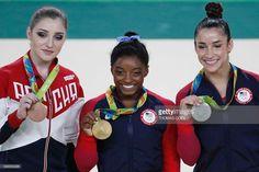 Russia's Aliya Mustafina, US gymnast Simone Biles and US gymnast Alexandra…