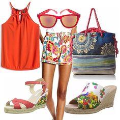 Colorato, con i colori caldi dell' estate questo outfit è ideale per un aperitivo in spiaggia. Con borsa ampia da poter mettere il telo mare e comodità necessaria per un momento di relax.