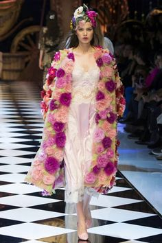 Dolce&Gabbana Fall-Winter 2016-17 #DGFabulousFantasy Women's Fashion Show. Lingerie as Outwear with a Silk Petticoat and an Elegant Coat of Roses. More insights on @dolcegabbana and #dgfw17. Also follow @voguerunway and #MFW.