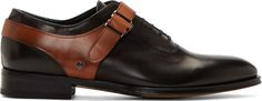 Alexander Mcqueen: Black Leather Harness Oxfords... Buffed leather oxfords in black. Almond toe. Tonal lace-up closure. Contrasting harness strap at body in brown with press-stud fastening. Tonal stitching. Upper: leather. Sole: leather, rubber. Made in Italy